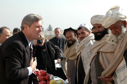 Tom Vilsack talks with apple farmers in southern Afghanistan