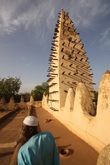Man in front of a minarett of Bobo-Dioulassos old mosque (Raphael Bick) Tags: africa travel burkina fao