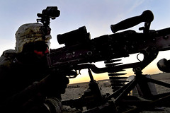 Manning an M-240B machine gun