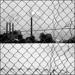 Factory life #2 (Kenneth McNeil) Tags: autumn winter urban blackandwhite bw white snow black industry 120 6x6 work fence mediumformat copenhagen square denmark wire construction industrial factory