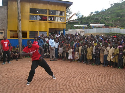 A song and dance performance for children in a Rwandan town.