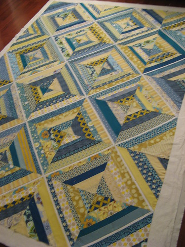 blue and yellow string quilt ready to be baster