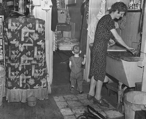 Tenement kitchen in the Chelsea section of Manhattan, August 26, 1941.