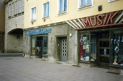 Geschfte,Magdeburg DDR.May 1990  Opticians and Music shops (sludgegulper) Tags: music shop architecture laden magdeburg ddr schmidt musik geschft gdr 1990 geschfte optician brillen opticians stalinist optik geschaeft