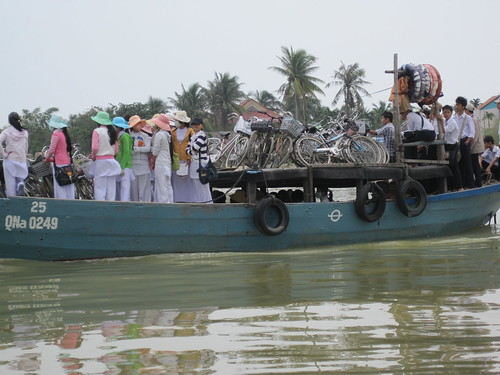 Hoi An, Vietnam - the locals using a ferry to cross the river