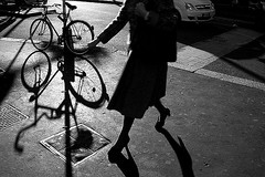 (33) - More news about bike, women's and shadows (Donato Buccella / sibemolle) Tags: street blackandwhite bw italy woman milan bike shadows milano streetphotography bicicletta sanbabila canon400d sibemolle peccatoperlamacchinadietromquimidàfastiidio fotografiastradale