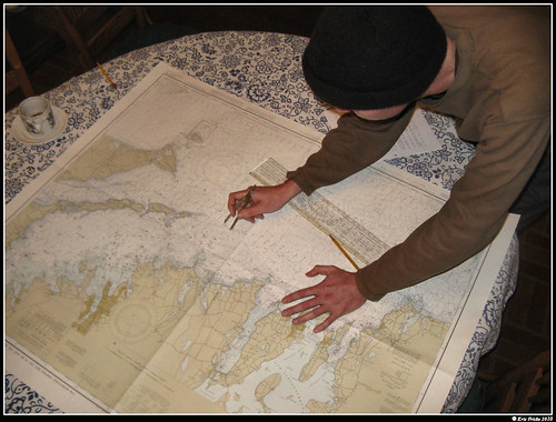 Our dashing protagonist plots a course on a nautical chart
