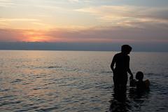 An hopefully sunset in Sicily (linfra1) Tags: girls sunset sea seaside nikon italia bambini dream help 1855 nikkor sole sicilia d40 pastello nikond40 braccioli