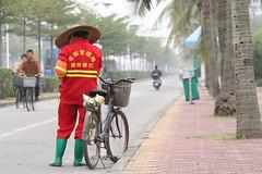 IMG_8559 Zhanjiang, China (HAKANU) Tags: china street city sea hat bicycle port guangdong canton rubberboots guangdongprovince southchinasea eastport kanton zhanjiang southeastchina fortbayard