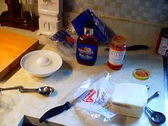 egg stting in warm water, BBQ sauce, salsa, Mozzarella block
