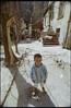 Čičko (OverdeaR [donkey's talking monkey's nodding]) Tags: stari grad singidunum beograd gypsie kid contralight shadows shack cpl straćara straćare ciganče dorčol majka šipka portrait ferrania solaris fg100 100ei tokina sl rmc 1735 17mm f35 nikon fe c41 negative scanned expired film streetphotography belgrade scan
