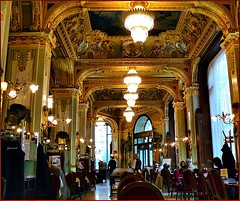 Budapest cafs - Caf New-York (jackfre2 (on a trip-voyage-reis-reise)) Tags: light newyork cakes fountain coffee caf bronze stairs hotel hungary chairs tea chocolate budapest decoration silk palace literature velvet ceiling tables lamps marble pillars gilded luxury tarts waiters rococo institution roccoco venetianchandeliers cafnewyork mmejackfre sculptedpanels