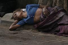 Street Slumber (dark eyes and careless hair) Tags: woman buttons sidewalk bombay ribs oldwoman mumbai saree banyantree blueblouse hareramaharekrishna