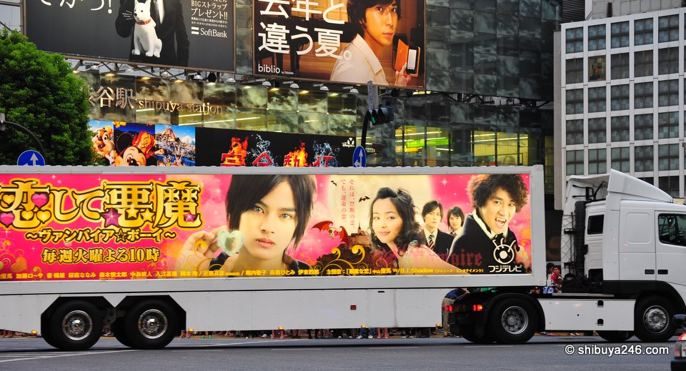 Large truck ads for new TV show on Fuji Television roar by