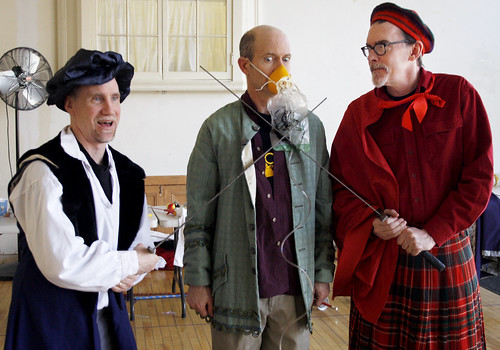 February 9, 2010 - At the rehersal for The Complete Works of William Shakespeare (Abridged) Brian Joseph Smith (left) and Phil Kilbourne (right) threaten Sam Rush with swords while he pleads through his in-case-of-emergency mask.