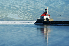 duluth lighthouse (Dan Anderson.) Tags: light lighthouse lake reflection ice water minnesota clouds america sunrise landscape harbor pier boat ship south ships superior greatlakes beacon mn duluth lakesuperior navigation canalpark duluthharbor southbreakwaterouterlighthouse southpierlighthouse southbreakwater bestofmywinners inlandseaport