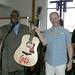 Wayne presents the guitar to Sheriff Greg Hamilton, Tom Morello