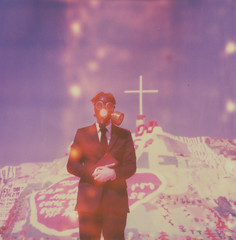 (theonlymagicleftisart) Tags: polaroid sx70 cross preacher religion jesus theend apocalypse roadtrip lightleak bible gasmask arcadefire expired salvation saltonsea timezero salvationmountain neonbible impossibleproject workingforthechurchwhileyourfamilydies