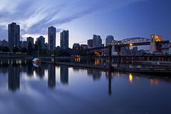 West End @ Dawn (Claire Chao) Tags: longexposure bridge summer canada reflection vancouver sunrise dawn pier downtown cityscape harbour britishcolumbia jetty bluesky falsecreek l englishbay bluehour westend beforesunrise burrardbridge citylight longexposures vanierpark downtownvancouver llens westendvancouver canon1635mmf28 canoneos5dmarkii sunriseview westendofvancouver