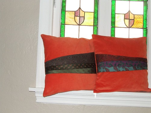 Be good to your couch... Orange velour necktie appliqued couch pillows