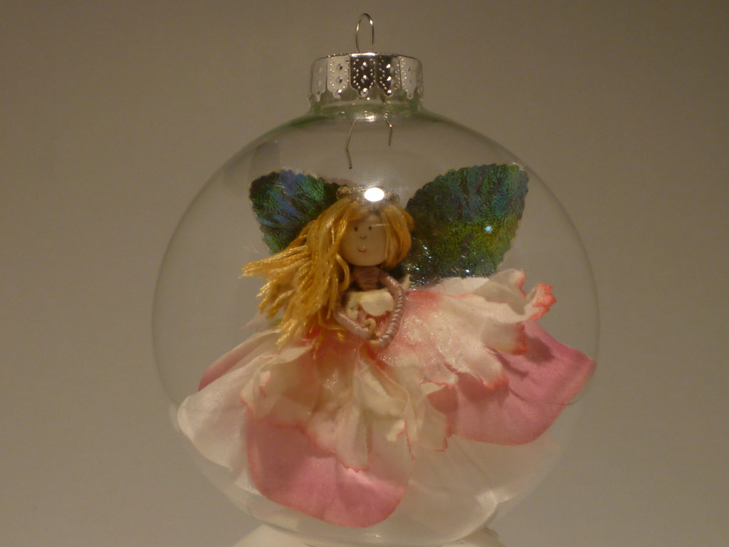 Angel Suspended Inside Hollow Glass Ornament