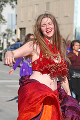 Whole Lot of Shaking Going On (wyojones) Tags: thanksgiving red woman girl beautiful moving downtown pretty texas houston bellydancer dancer parade belly shake brunette 2009 midriff heb thanksgivingdayparade holidayparade hebhoustonholidayparade