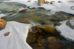 River Rocks (Billy Wilson Photography) Tags: winter snow ontario canada motion cold ice nature rock digital canon river landscape outdoors eos rebel dangerous rocks colorful outdoor tripod january rapids clean colourful xs soo northern pure rapid saultstemarie northernontario slowshutterspeed pristine algoma billywilson saintmarysriver
