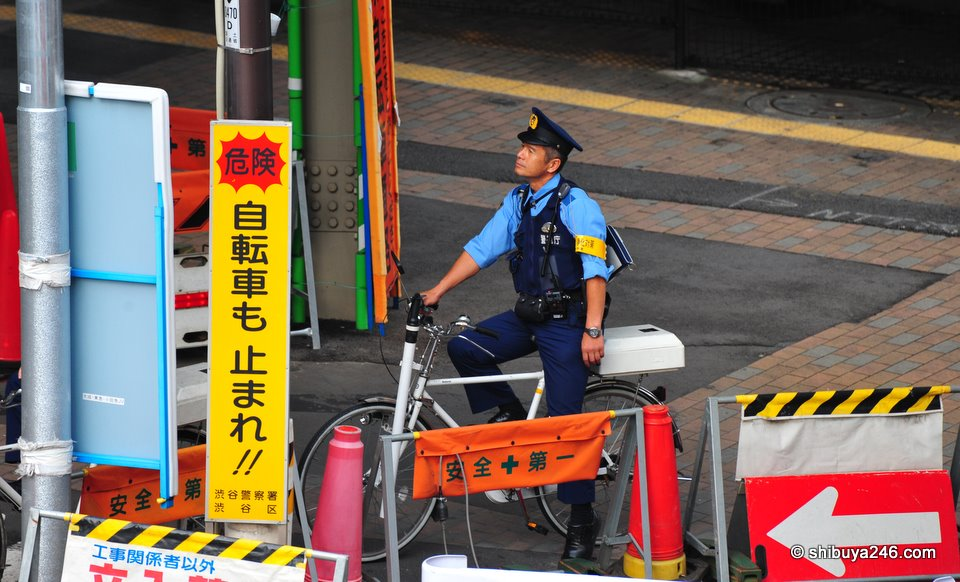 A policeman contemplating his ride home. Maybe he is looking up at Horikita Maki