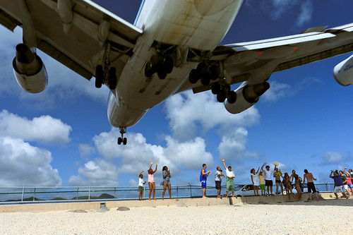 Plane Landing 10 meters off the beach - Duck! Thrill-seeking people are heading to a beach on the Caribbean island of St. Maarten, where Boeing 747s fly so close above your head that they darken the skies. A perfect and unique way to start your day in St. Maarten, without coffee.       (July 14, 2009)