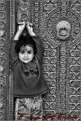 I'll be waiting .. ! (Fahad S. Al Fahdi) Tags: life door old white black cute girl al holding missing waiting moments alone child sad hard adorable future someone lovely oman fahad omani flickraward fahdi