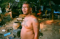 (NateVenture) Tags: travel portrait man film tattoo analog thailand person thai pointandshoot konica s400 superia400 rayong pattaya pns bigmini route3 chonburi jomtien 3535 sattahip  bm302
