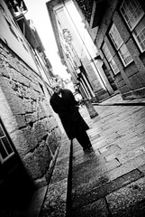 Black Walking (Andrea_b.) Tags: street light people urban bw blur portugal vanishingpoint perspective reportage guimares workingclass clairobscur nikon20mmf28 fujis5pro ofstreet thephotoleague2