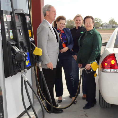 State Director Moul (Right) fills up a car with an ethanol blend.