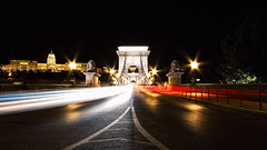 Szchenyi Traffic (TheFella) Tags: road longexposure bridge light slr castle cars night digital canon eos photo lowlight europe hungary traffic suspension budapest lion trails palace unescoworldheritagesite unesco chain nighttime photograph lane processing slowshutter lions lighttrails lamps dslr duna danube buda pest royalpalace lanes magyarorszg traffictrails lnchd riverdanube budacastle chainbridge royalcastle postprocessing 500d szchenyi szchenyilnchd szchenyichainbridge budavripalota republicofhungary kirlyivr istvnszchenyi kirlyipalota twtmews chainsuspension