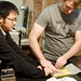 Tim Hwang and Jeff vacuum-seel lobster tails in a butter sauce