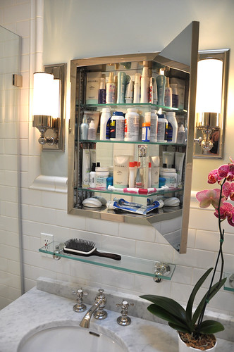 Mirrored medicine cabinet above the sink with door open
