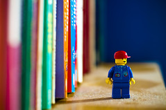 Taken For Granted (michaeljosh) Tags: macro toys lego bookshelf depthoffield nikkor50mmf14d legoman project365 takenforgranted dustyshelf nikond90 michaeljosh gatheringupdust legospaceshuttleset