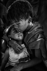 Smolky Mountain, Tondo  - Brotherly Love (Black & White) (Mio Cade) Tags: boy mountain love children kid feeding brother philippines manila smoky care heavy brotherly tondo programmes