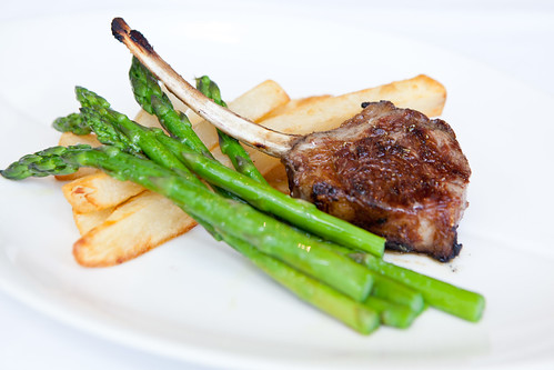 Lamb chop, fries and steamed asparagus