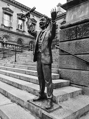Speaker, Custom Square, Belfast (helenthrelfall) Tags: sculpture city customhouse belfast bw monochrome people statue urban iphone steps speaker