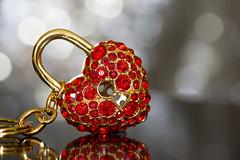 Macro Mondays - Hearts (cuppyuppycake) Tags: hearts macro monday hmm macromonday key jewlery keychain bokeh closeup heart sparkly sparkle gold ruby gem