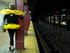 Waiting For The Bee-Train (an untrained eye) Tags: newyork colour halloween topf25 topv111 subway costume wings topv333 unitedstates manhattan candid streetphotography topv222 bee essexstreet interestingness26 interestingness101 interestingness33 anuntrainedeye explore15nov09 whichmeansitsreachednumber101inexplore thoughisupposeyoucouldarguethatsomeofthecompositionalelements womanquirkyoutfitbrightcolours mightberecommendedinahowtogetintoexplore101class yeahiguesstheremusthavebeenalatesurgeininterestwhichisnice