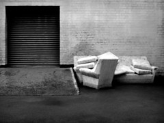 (Delay Tactics) Tags: bw white 3 black wall living three chair ramp room sheffield lounge front warehouse sofa fabric shutter suite piece slope untidy