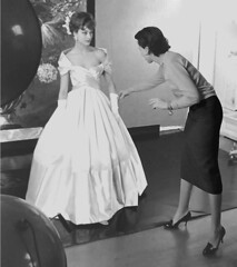 Marie Helene Arnoud in 1957, with a tight-skirted photographers assistant squeezing the last inch out of her straight skirt. (50'sfan) Tags: highheels eveninggown straightskirt mariehelenearnoud