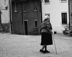 Going home... - Tornando a casa... (Cristiano Ercolani) Tags: blackandwhite bw canon walking eos country campagna goinghome granny olderwoman paese 500d camminare tornareacasa signoraanziana andareacasa cristianoercolani