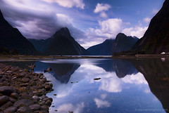 Milford Sound @ Dusk (stevoarnold) Tags: longexposure blue sunset newzealand sky mountain reflection water clouds dusk pebbles lotr sound southisland fjord milfordsound fiord mitrepeak blogtravel alpha200