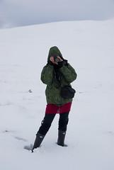 Strathy_Scotland_198 (jjay69) Tags: uk winter england woman snow ice walking scotland frost wind britain hill footprints freezing photograph freeze bern wellingtonboots icy sutherland chill whiteout struggle reddress rockfish takingapicture deepsnow greenjacket strathy northernscotland