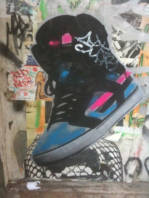 big wheatpaste shoe on the wall #walkingtoworktoday
