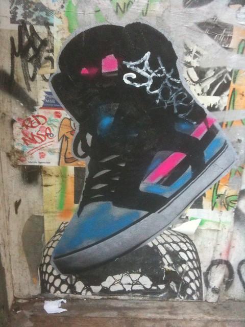 big wheatpaste shoe on the wall #walkingtoworktoday