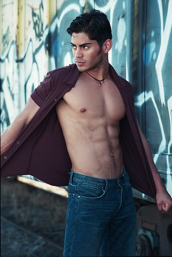 sexy male model open his shirt button shows his muscle body